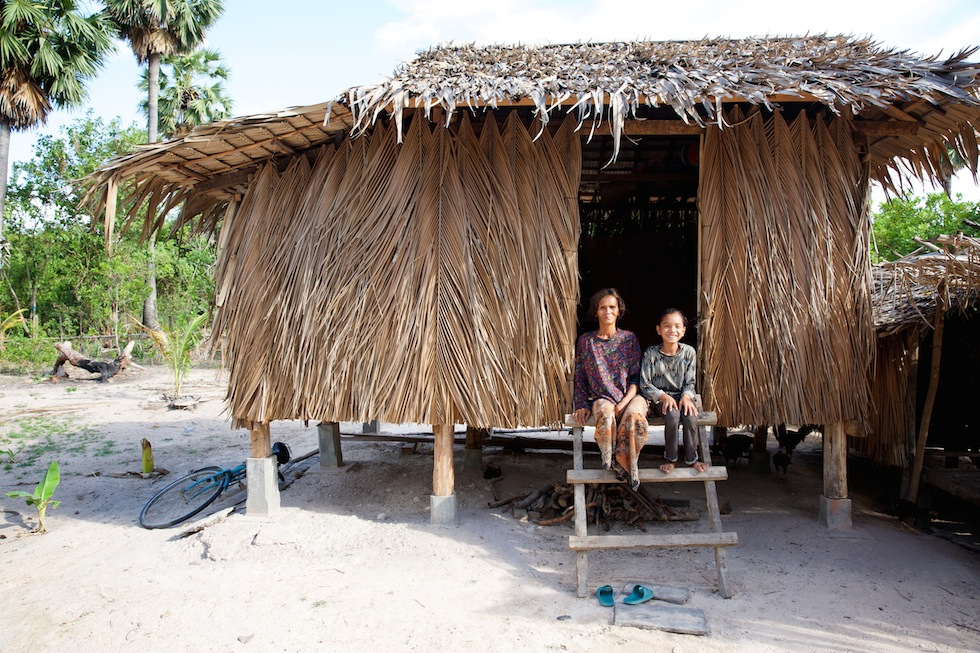 (L) Sokhat (13) is pictured with her mother Mean Khon, (52) sitting outside their home in a village on the outskirts of Siem Reap province, Cambodia.